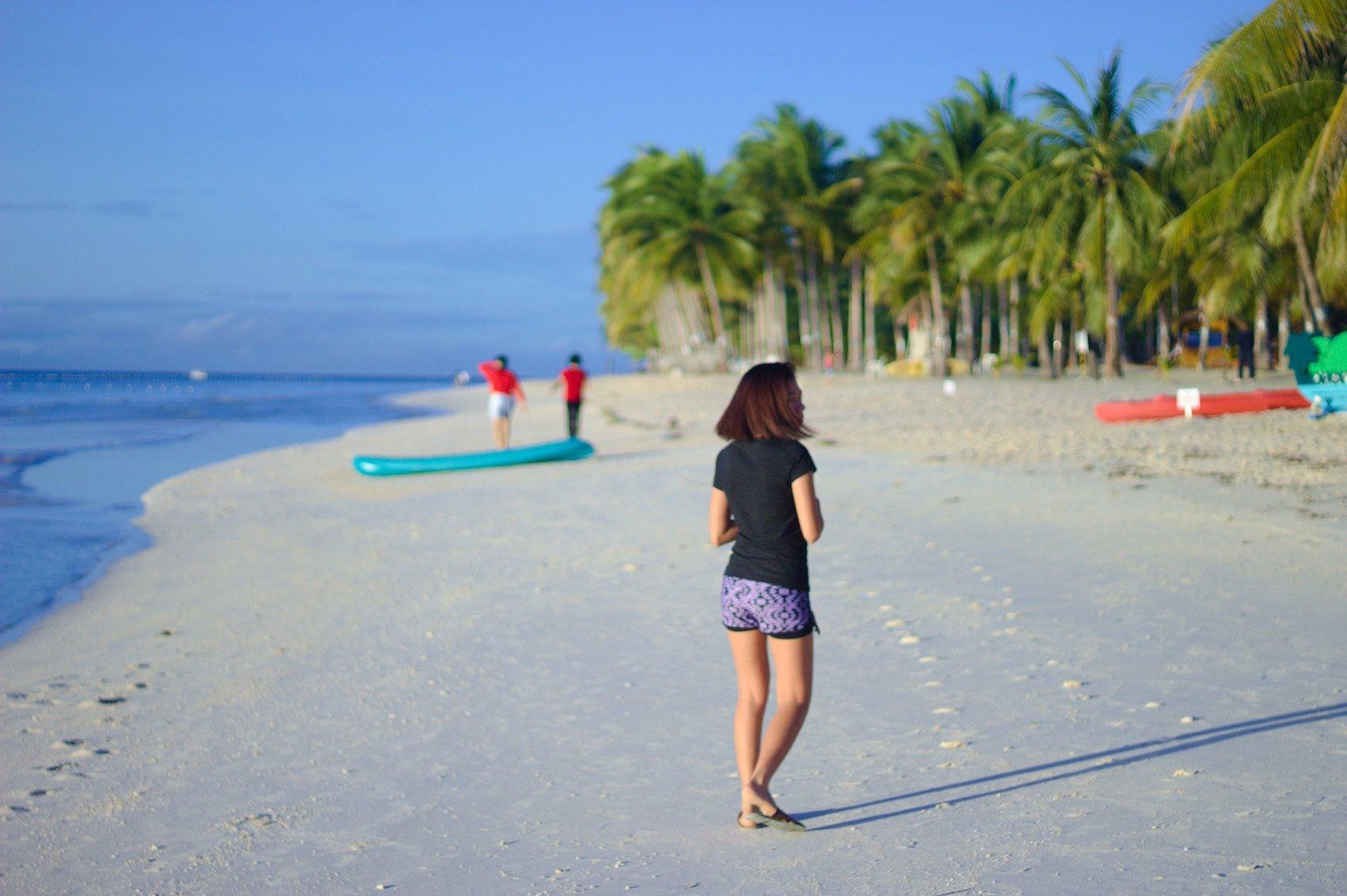 Female Loss Of Hair Woman On Beach