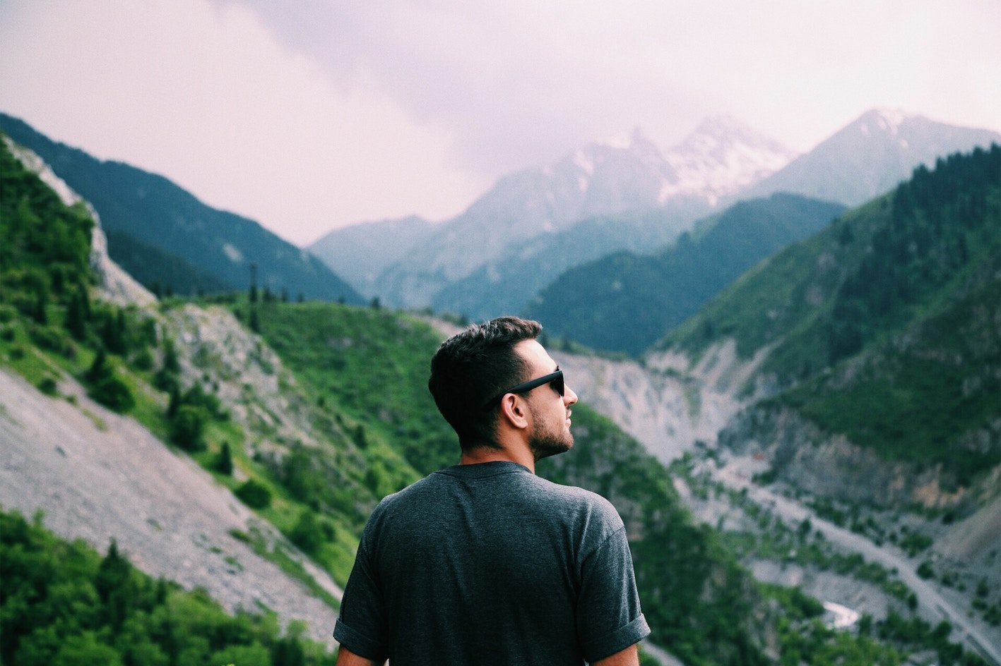 Male Hair Loss Explained Man Overlooking Mountains