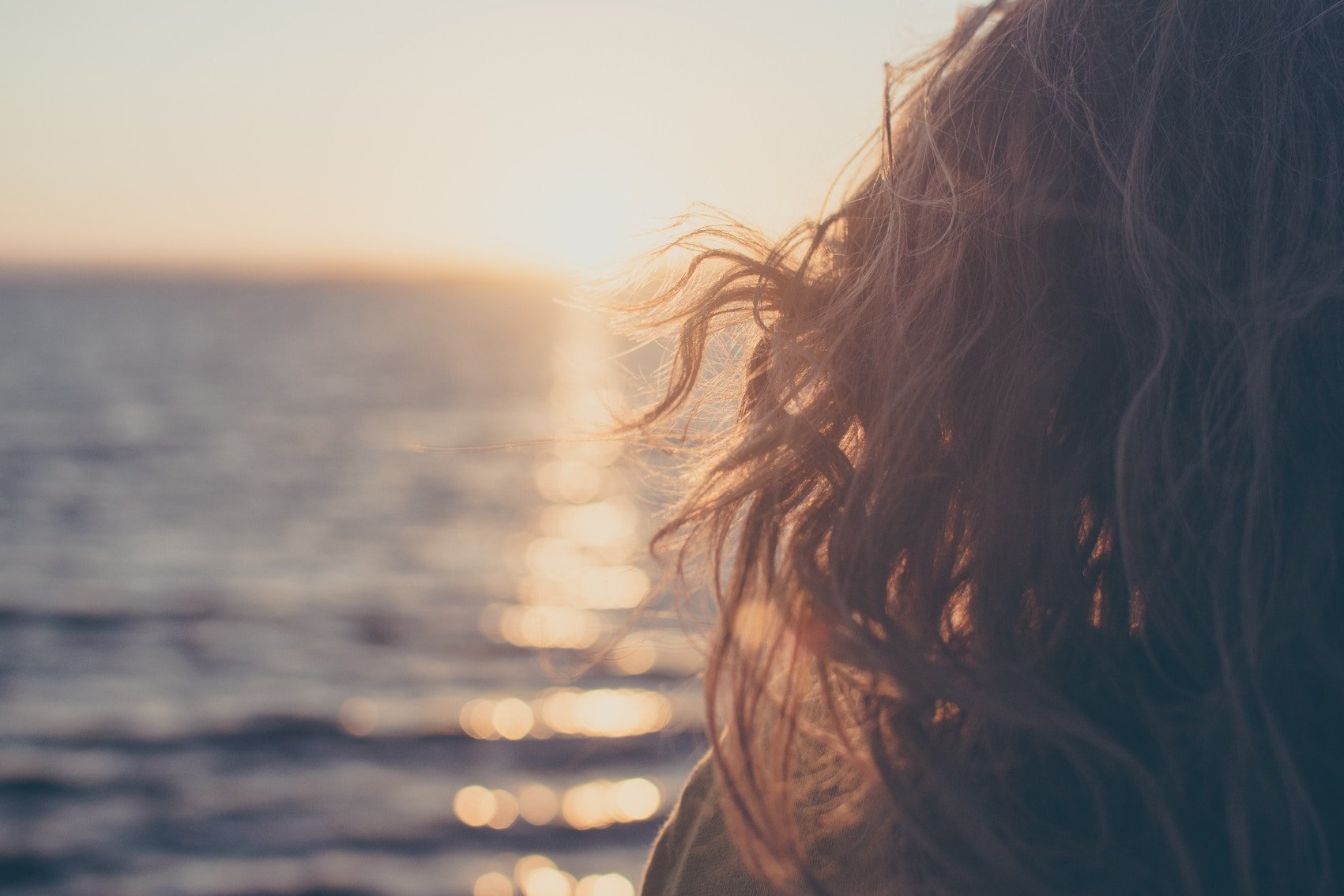 Girl Over Looking Ocean At Sunset